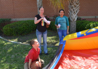 Children playing with family at the 2018 spring fling at Galveston College Main Campus