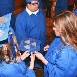 Galveston College graduates admire decorated cap at ceremony