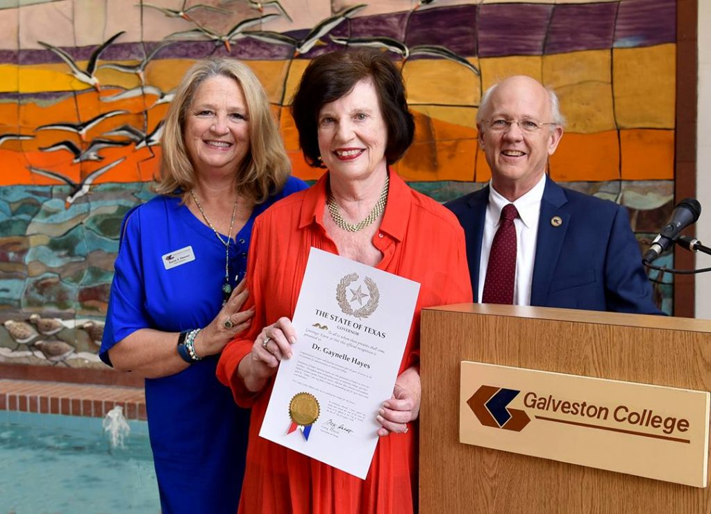 Galveston Community College District Board of Regents Chair Karen Flowers and Galveston College President Myles Shelton honor Dr. Hayes with a resolution from the board